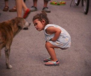 A curious child inspects pet dog. (Source: depositphotos)